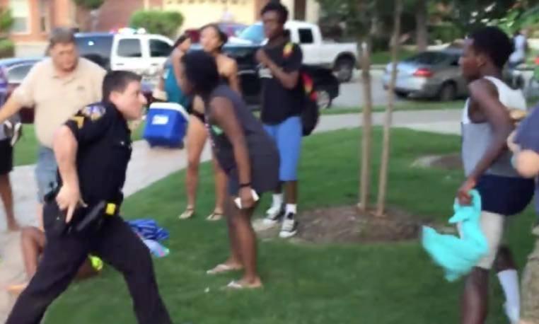 cop pulls gun