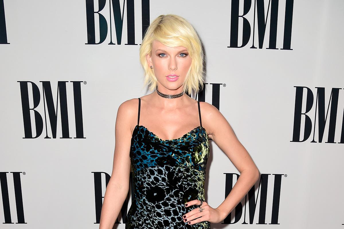 8278ff84d256f Flipboard  Taylor Swift Fuels Breast Implant Rumors in New Bathing ...