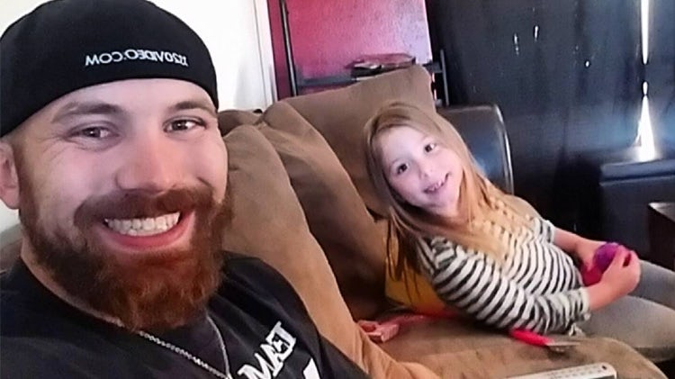 Adam Lind and daughter Aubree sitting on a couch
