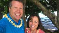 Jim Bob and Michelle Duggar Wearing Leis