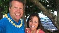 Jim Bob and Michelle Duggar Wearing Leis