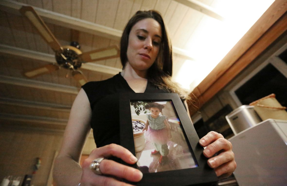 Casey Anthony Holds Picture of Daughter Cayley