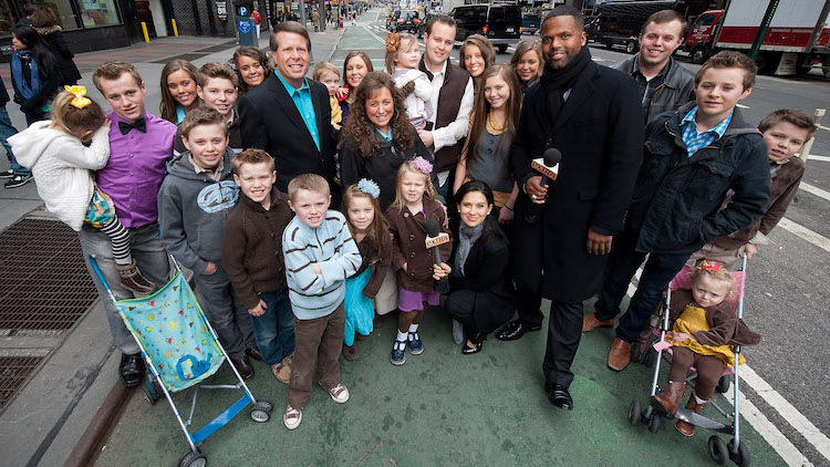 photo of the duggar family standing in the street