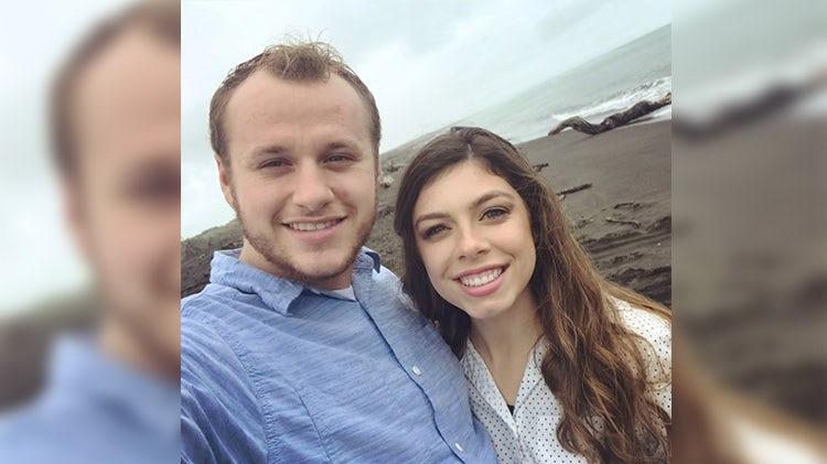 josiah and lauren duggar on a beach