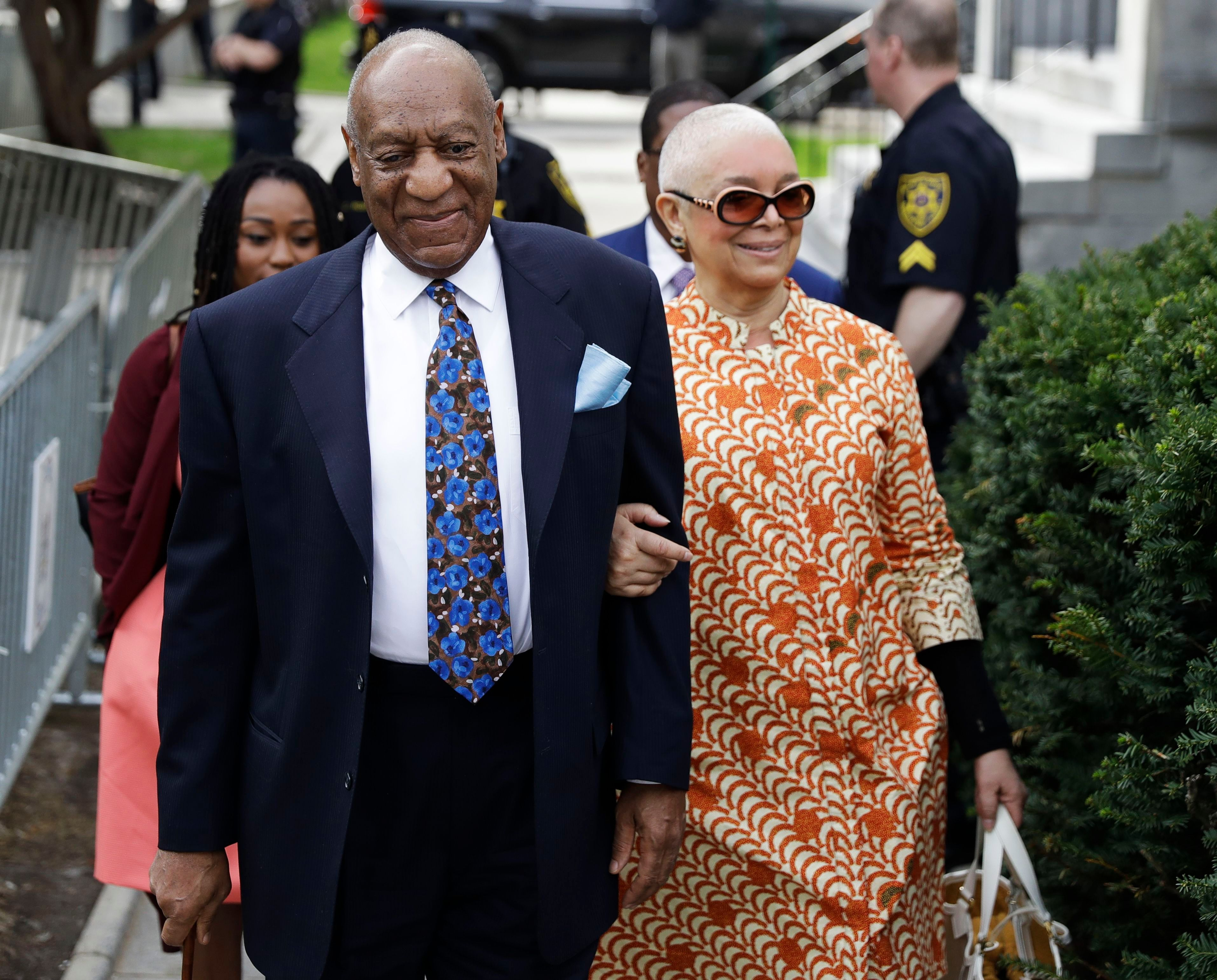 Bill and Camille Cosby Walking Into Court Arm-in-Arm