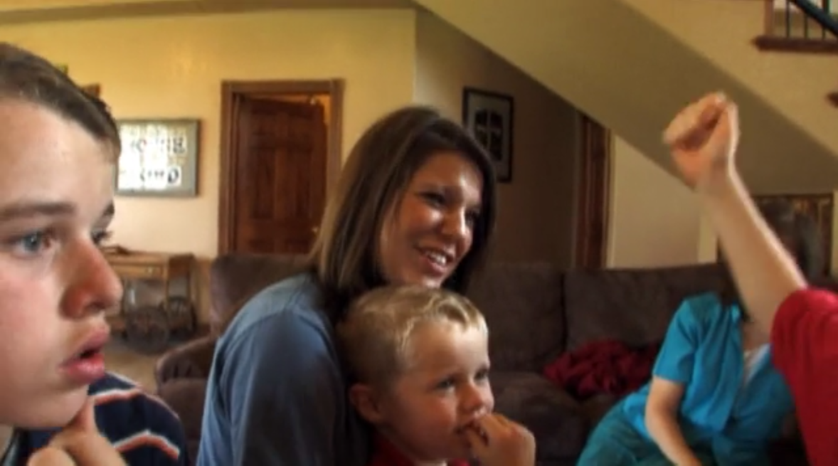 amy duggar with a young duggar child.