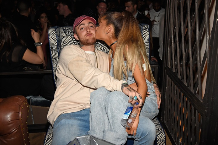 Mac Miller and Ariana Grande kissing at an event