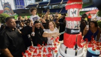 DJ Khaled, Nicole Tuck, and Asahd Cut Birthday Cake