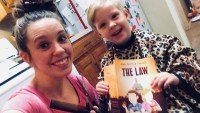 Jill Duggar And Son Israel Holding A Book