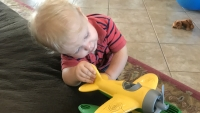 Henry Seewald Plays With Toy Plane