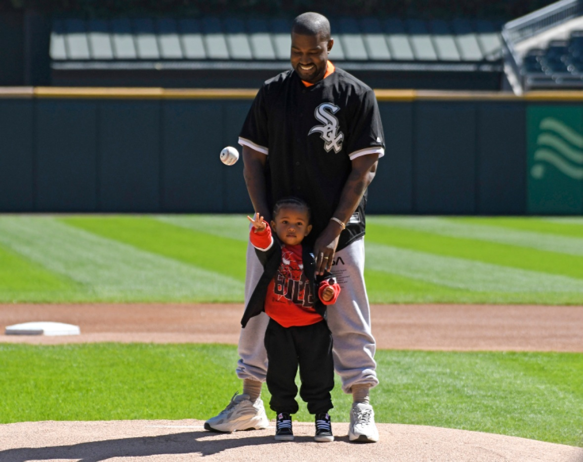 kanye west helps saint west throw first pitch at white sox game