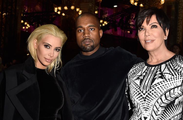 Kim Kardashian with blonde hair sitting with Kanye West and Kris Jenner