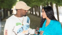 Kim Kardashian And Kanye West Looking At Each Other