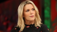 Megyn Kelly sitting wearing black with closed mouth