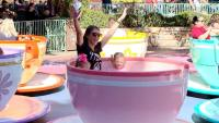 Danielle Busby And Daughters Ride Spinning Teacups At Disneyland