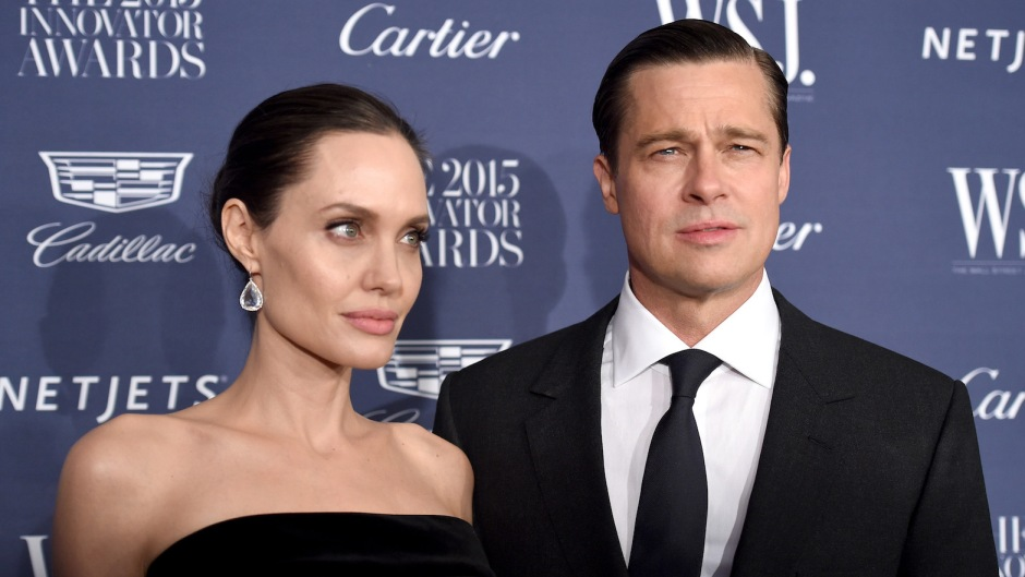 Angelina Jolie and Brad Pitt wearing all black at an event together
