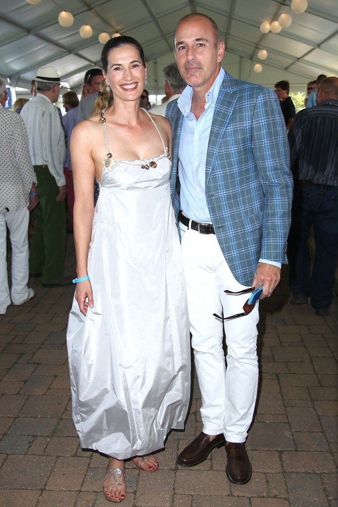 Matt Lauer and Annette Roque at an event together, she is wearing a silver dress