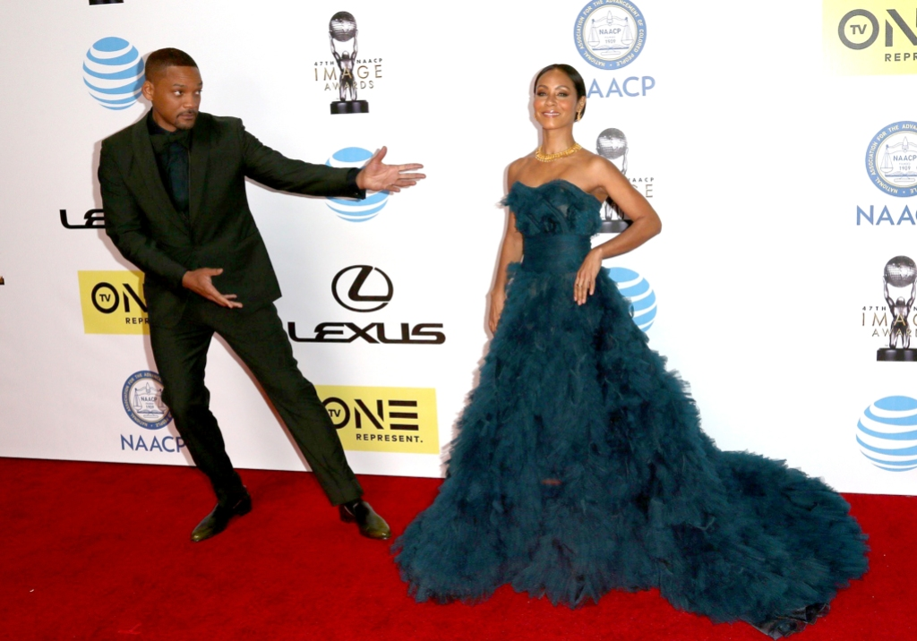 Will Smith acting funny and presenting Jada Smith, wearing a huge green/blue gown