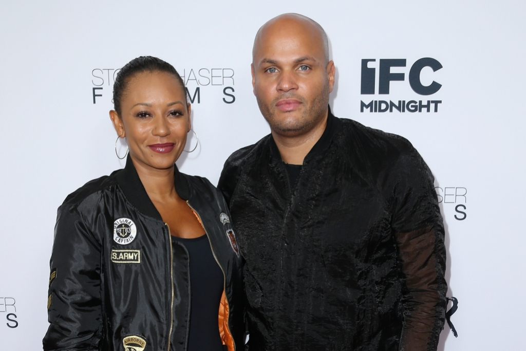 Mel B wearing a leather jacket with Stephen Belafonte, also wearing black