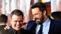 Ben Affleck and Matt Damon laughing at each other