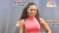 Mel B wearing a pink outfit on a red carpet