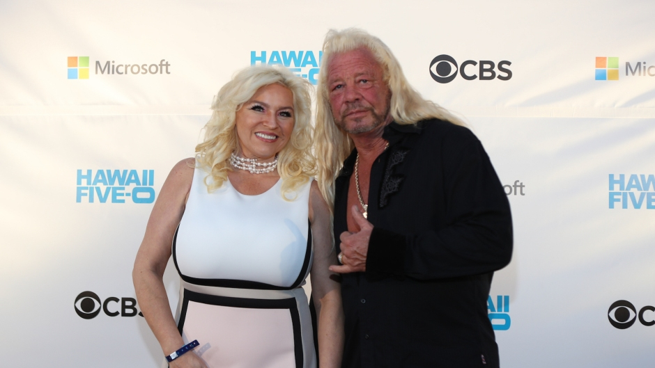 Beth and Duane Chapman at an event, Beth wearing white