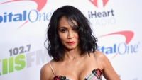 Jada Pinkett Smith wearing a plaid dress at Jingleball