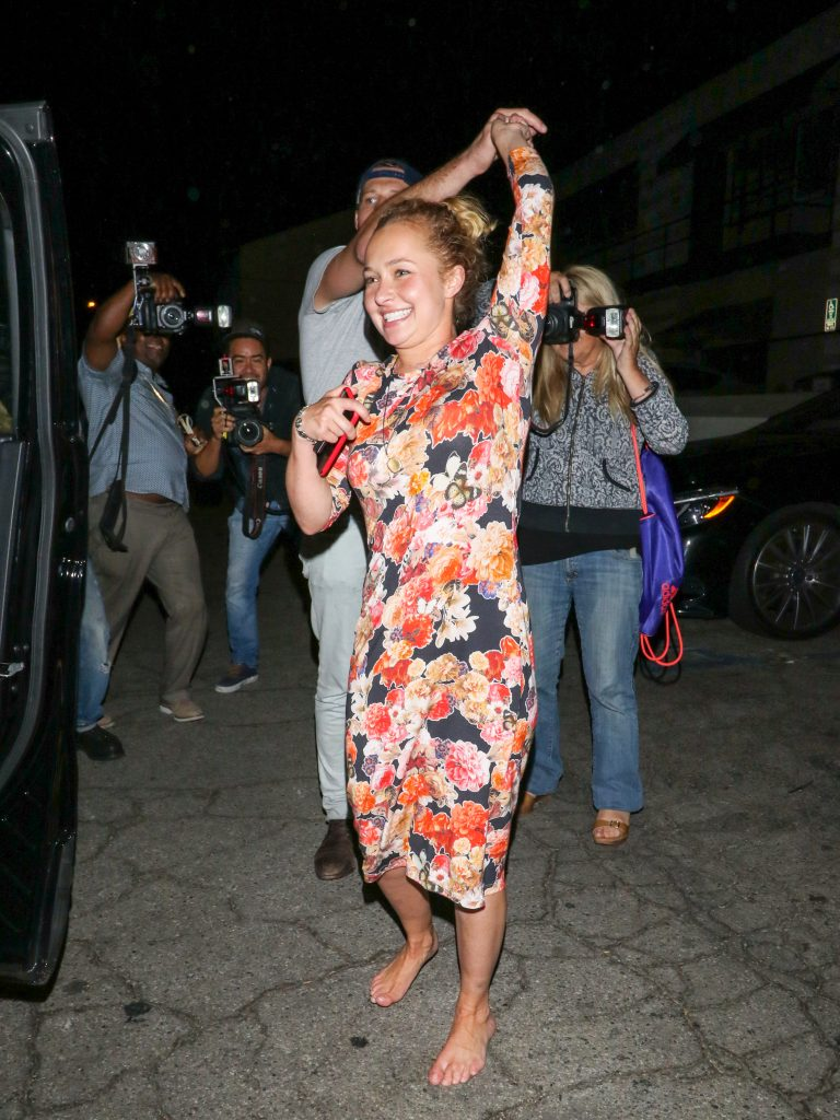 Hayden dancing in LA, wearing a flower dress, with no shoes on