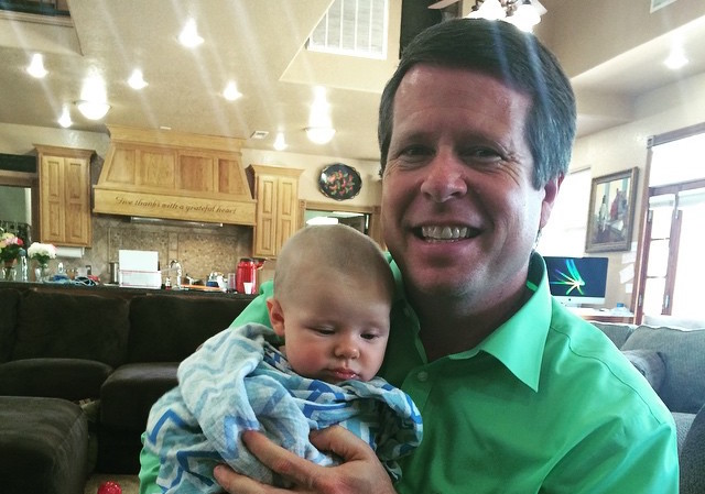 Jim Bob Duggar Holds Baby Grandchild At Home