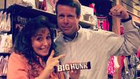 "Michelle Duggar Points To Flexing Jim Bob Duggar While Holding ""Big Hunk"" Candy Bar"