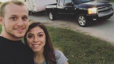 Josiah Duggar And Lauren Swanson Smiling In Front Of Truck And Trailer