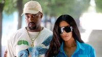 Kim Kardashian Wearing Sunglasses With Kanye West In Hat