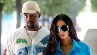 Kim Kardashian Wearing Sunglasses With Kanye West In Hat