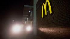 Car At McDonald's Drive-Thru At Night