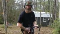 David Eason Poses With Rifle On His Property