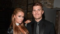Paris Hilton and Chris Zylka at an event