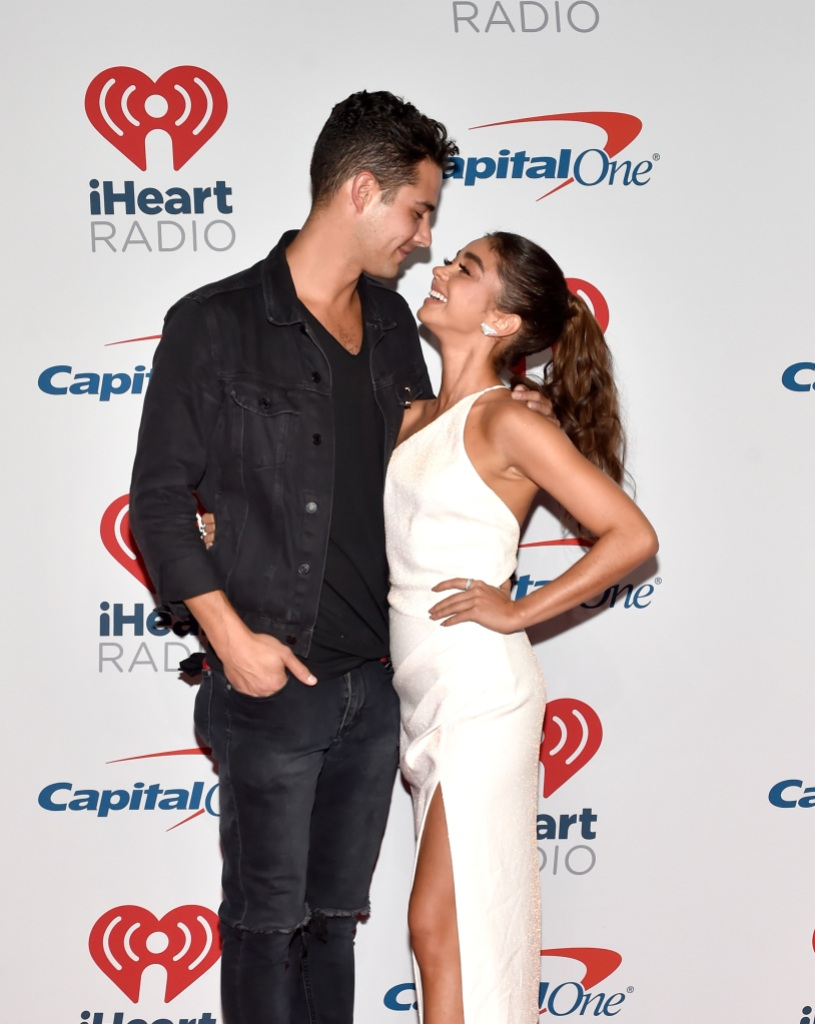 Wells Adams and Sarah Hyland wearing a white dress at an event