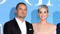 Katy Perry, dressed in pink with Orlando Bloom