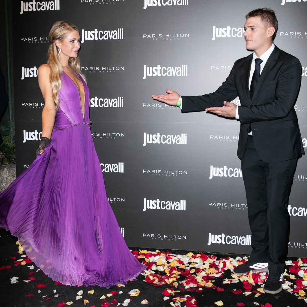 Paris Hilton is wearing a purple dress with Chris Zylka