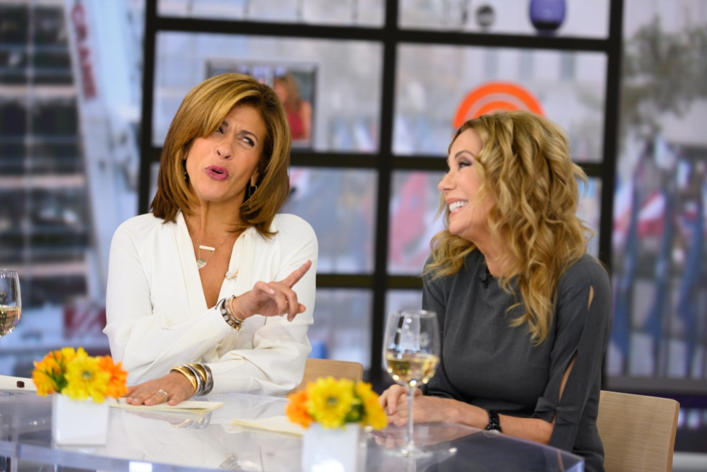 Hoda Kotb and Kathie Lee Gifford wearing white and gray on the Today Show set