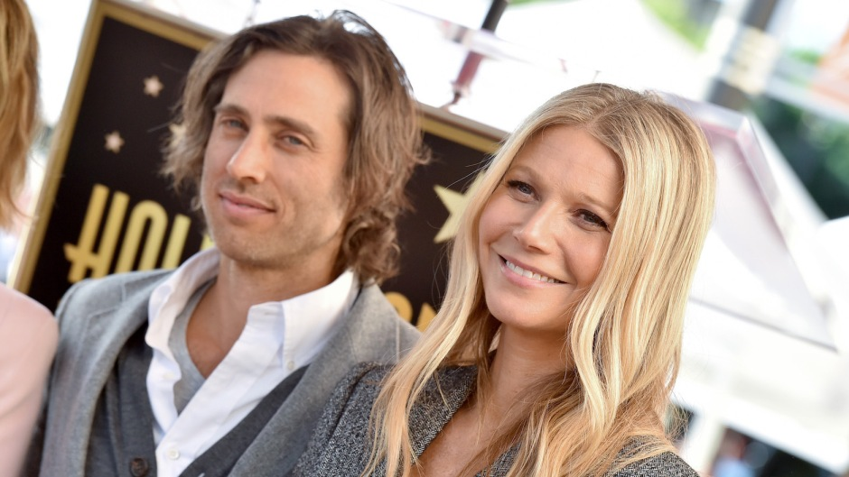 Gwyneth Paltrow and Brad Falchuk together at an event, Brad wearing a sweater vest