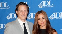 Meghan Markle wearing a black dress with Trevor Engelson
