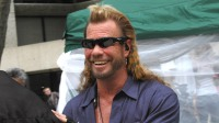 Duane Chapman wearing sunglasses and smiling
