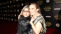 Billie Lourd with her mom Carrie Fisher hugging each other very tightly