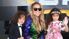 Mariah Carey with her twins at an event, she is wearing sunglasses