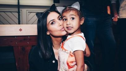 Kim Kardashian with North West wearing cat ears