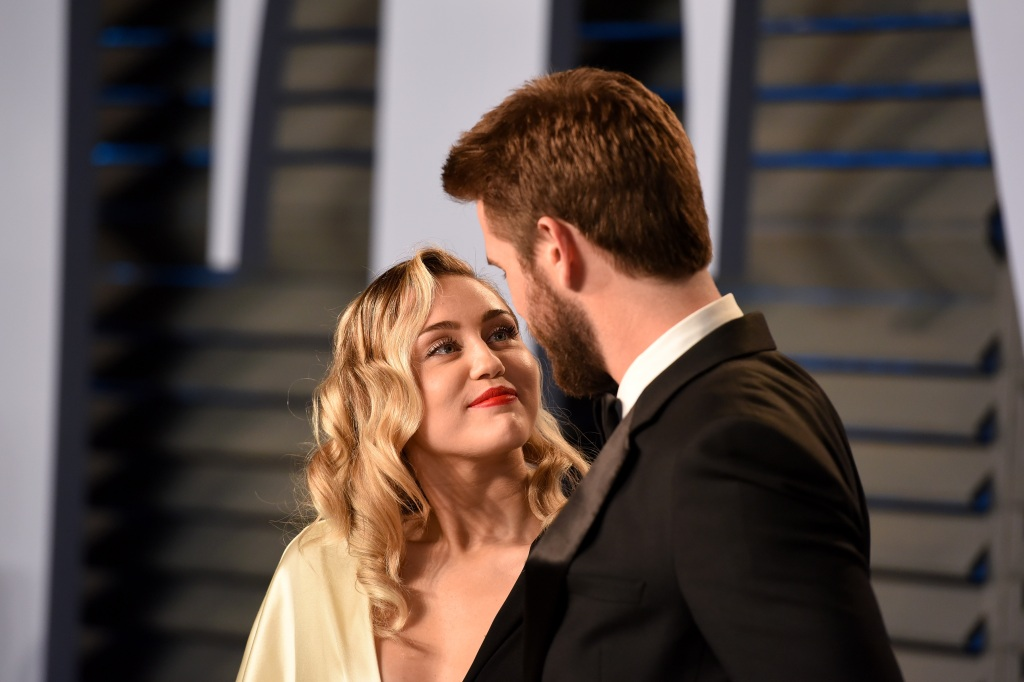 Miley Cyrus and Liam Hemsworth at an event together