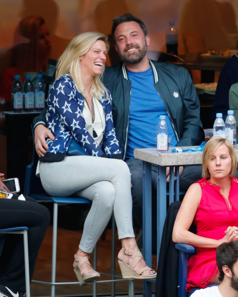 Ben Affleck and Lindsay Shookus laughing and sitting down
