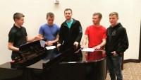 Eligible Duggar Bachelors Standing Around A Piano