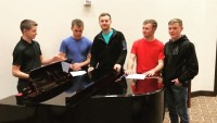 Eligible Duggar Bachelors Standing Around A Piano